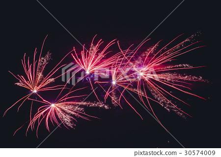 Fireworks exploding in violet colors 30574009