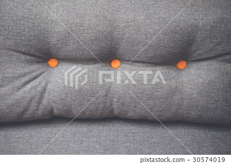 Pillow in grey color with orange buttons 30574019