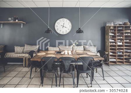 Dinner table in a retro living room 30574028