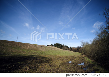 Landscape with hills and trees 30574069