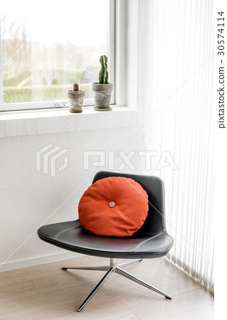 Black chair in a bright living room 30574114