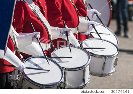 Drummers in red uniforms on a row 30574141