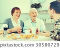 Grandparents and grandson breakfast 30580729
