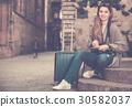 Girl holding brochure 30582037