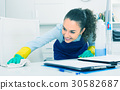 Female professional cleaner in office. 30582687