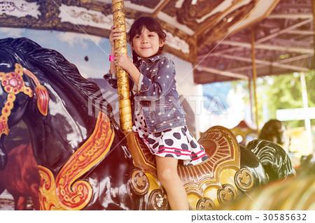 Little Girl Amusement Park Playful Merry Go Round 30585632