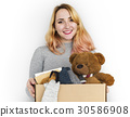 Woman Studio Portriat Casual Carrying a Box Isolated 30586908
