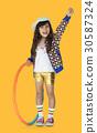 Little Girl Smiling Happiness Hula Hoop Studio Portrait 30587324
