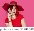 Caucasian Woman in a Red Dress Talking on the Phone 30588009