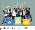 Kids and plastic bottles in a recycle bin 30588713