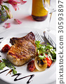 Beef steak with grilled vegetables 30593897