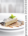 Cheesecake on white plate 30593930