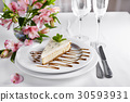 Cheesecake on white plate 30593931