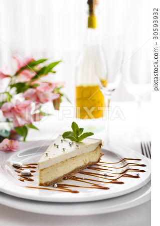 Cheesecake on white plate 30593932