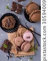 Chocolate macaroons with ice cream 30594009
