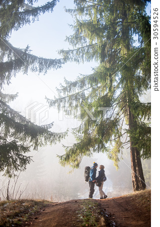 Man And Woman Backpackers Enjoying On Foggy Forest Stock Photo 30594526 Pixta