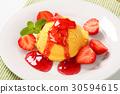 Yellow ice cream with strawberries 30594615