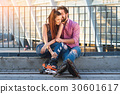 Romantic couple of rollerbladers. 30601617