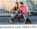Smiling couple with cellphones. 30601705