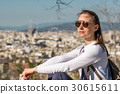 Woman overlooking Barcelona cityscape from Montjuic 30615611