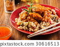 Chicken pieces with rice and sweet and sour sauce 30616513