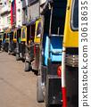 Yellow black rickshaws (tuk tuk). 30618635