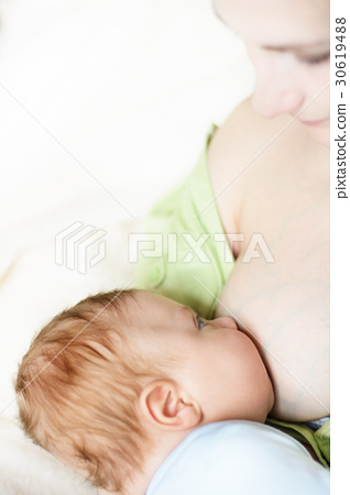 Mother breastfeeding her baby 30619488