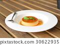 Caramel custard cake with peppermint leaf in plate 30622935