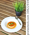 Caramel custard cake with peppermint leaf in plate 30622939