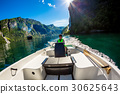 Woman driving a motor boat 30625643