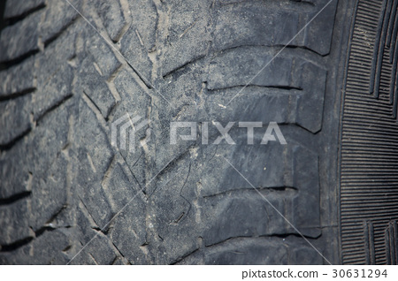 detail of old and dirty tire of car 30631294