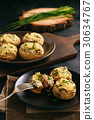 Baked mushroom caps stuffed with creams cheese. 30634767
