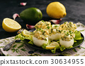 Stuffed eggs with avocado, garlic and leek. 30634955