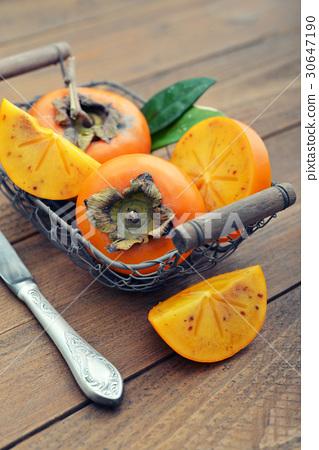 Ripe sweet persimmons 30647190