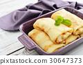 Stack of stuffed pancakes 30647373
