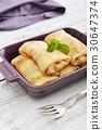 Stack of stuffed pancakes 30647374