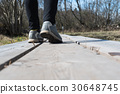 Walking on a wooden footpath 30648745