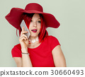 Caucasian Woman in a Red Dress Talking on the Phone 30660493