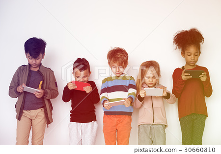 Group of Kids Using Digital Mobile Phone 30660810