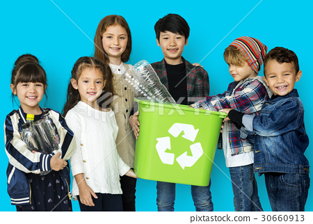 Kids and plastic bottles in a recycle bin 30660913