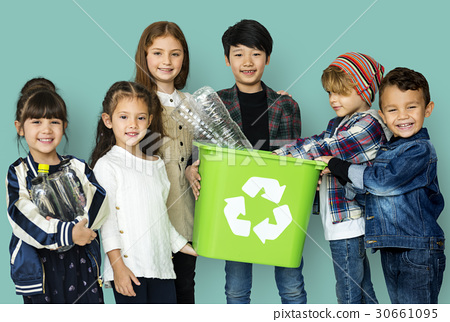Kids and plastic bottles in a recycle bin 30661095