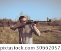 The man takes aim at the target with a sniper 30662057