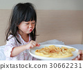 child girl looking Healthy breakfast egg omelet 30662231