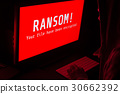 Computer screen with ransomware attacks alert red 30662392