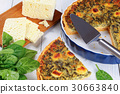 spinach, cheese vegetarian tart on table 30663840