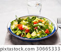 Healthy avocado spinach tomato salad 30665333