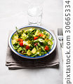 Healthy avocado spinach tomato salad 30665334