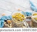 Chia oat pudding with quinoa, banana, pistachio 30665360