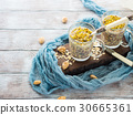 Chia oat pudding with quinoa, banana, pistachio 30665361