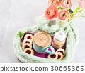 Mug of coffee cookies and flowers 30665365